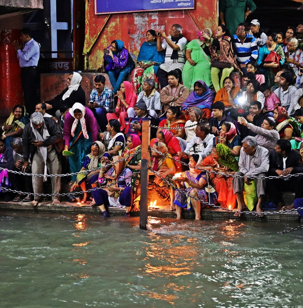 Putting diys in the Ganges at Ganga Aarti, Haridwar