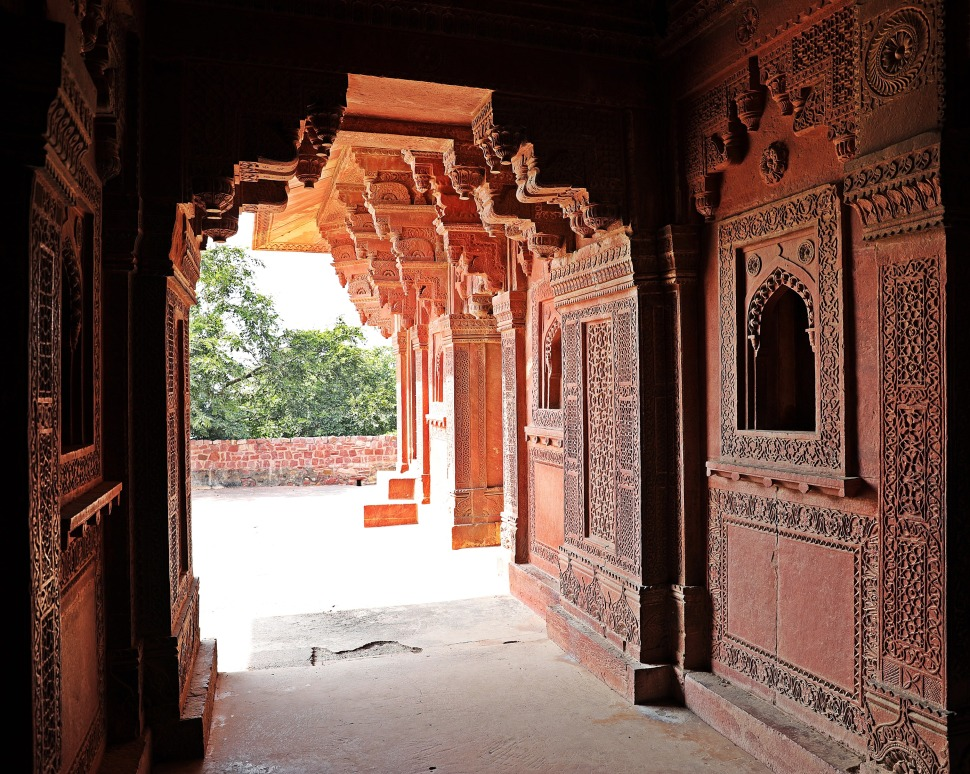 Intricate wall carvings inside a building in Fatehpur Sikri