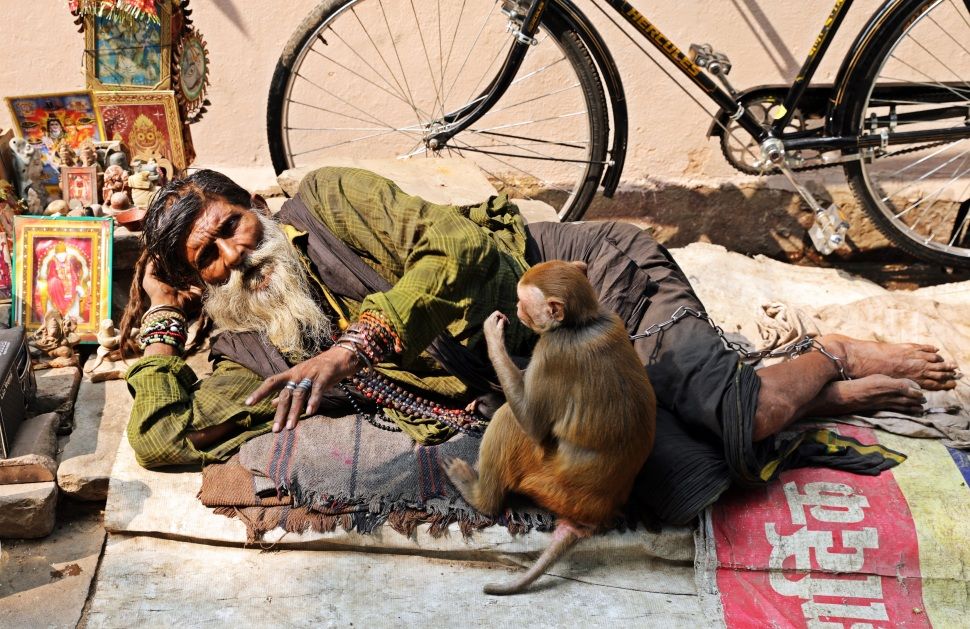 Homeless beggar with his monkey, Varanasi
