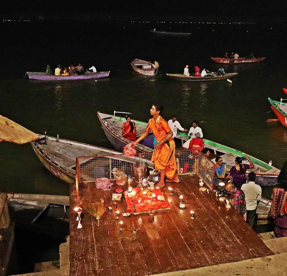 Lighting butter candles during Diwali, Varanasi