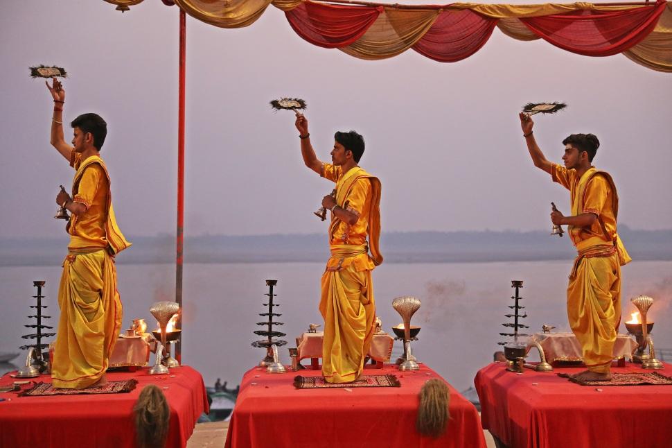 Pundits twirling peacock feathers, Ganga Aarti, Varanasi
