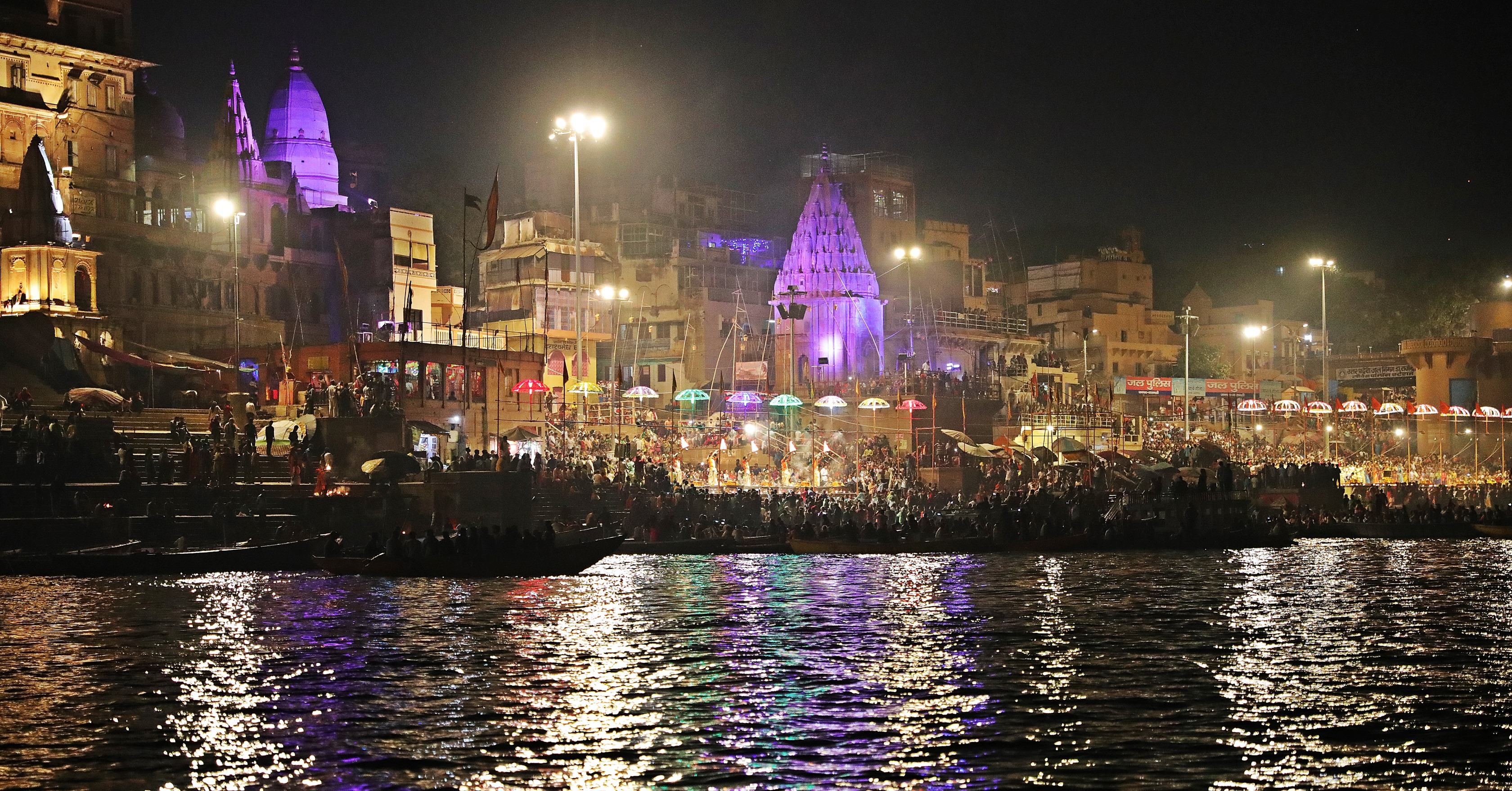 Spectators on boats watching Ganga Aarti in Varanasi