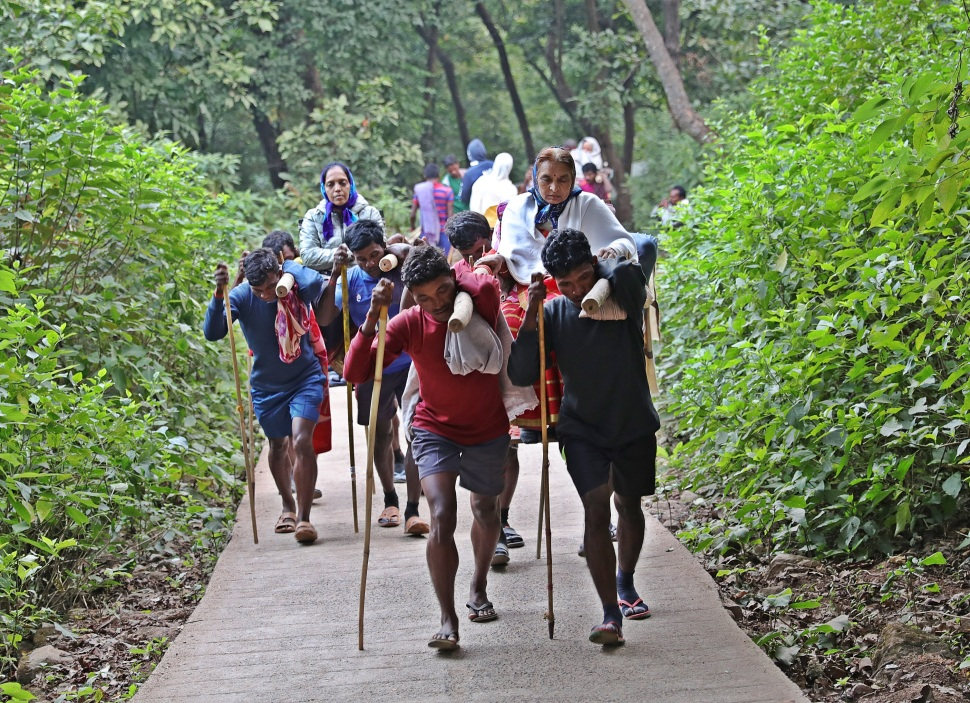 Pilgrims getting carried on a doli, Parasnath Hills