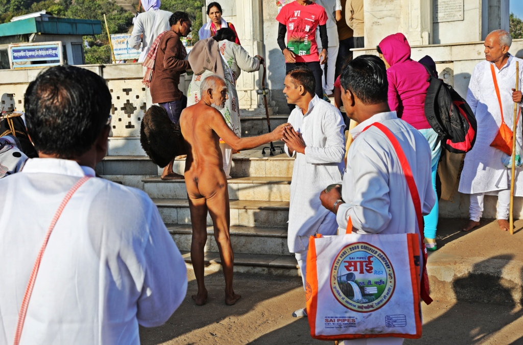 Jain priest greeting a devotee, Parasnath Hills