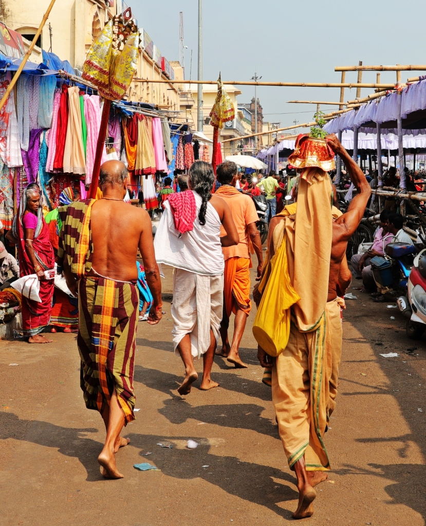 Men in traditional lungis and dhotis outside Jagannath Mandir, Puri