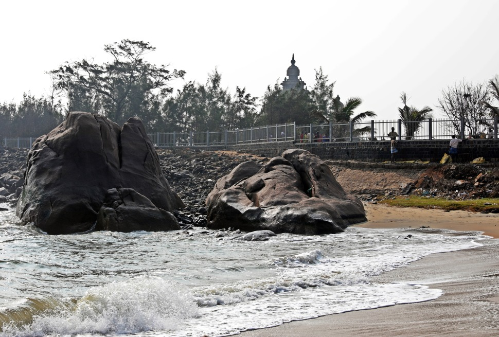 Coast boulders with the steeples of Seashore Temple behind
