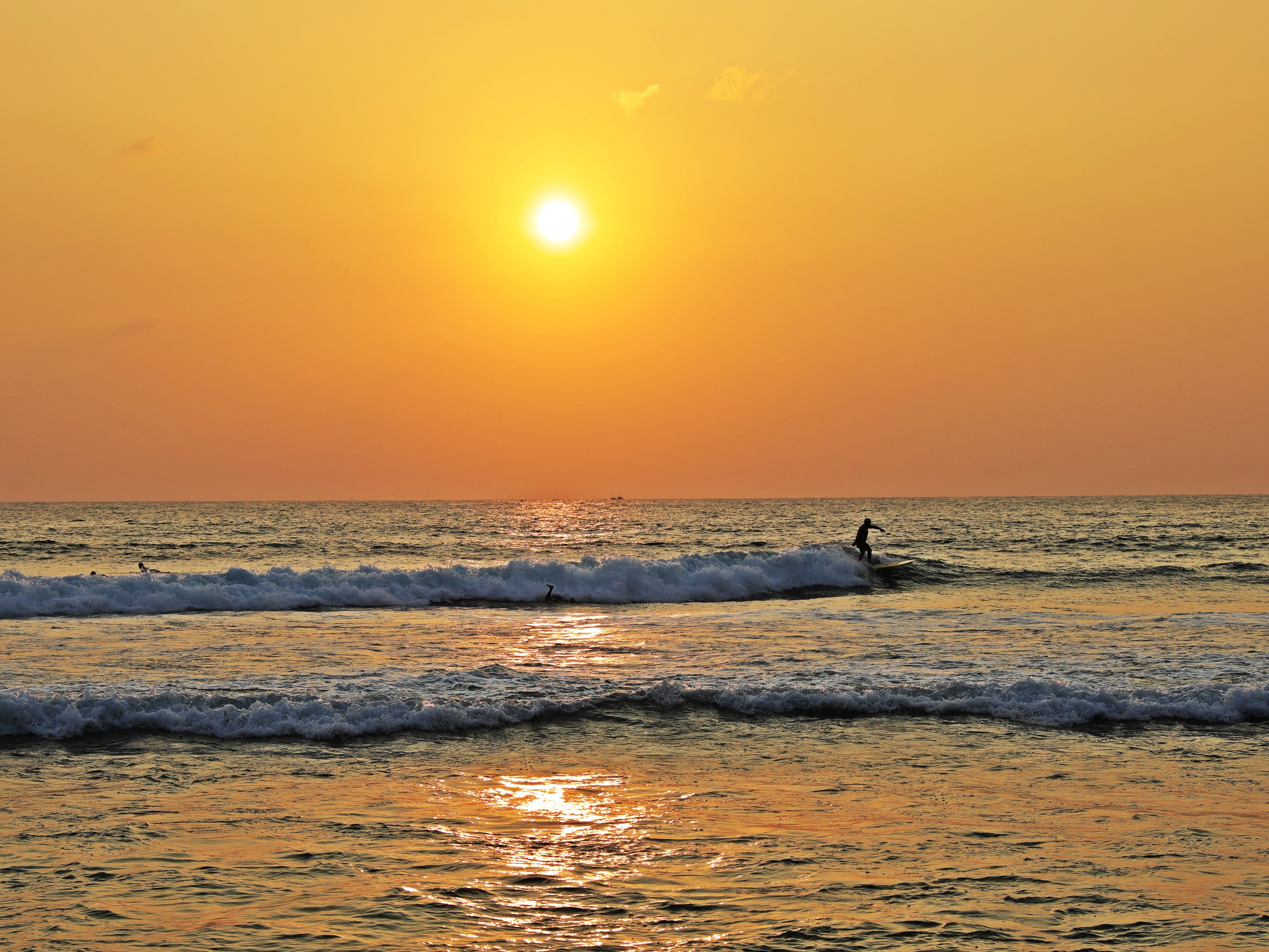Surfer at sunset, Hikkaduwa