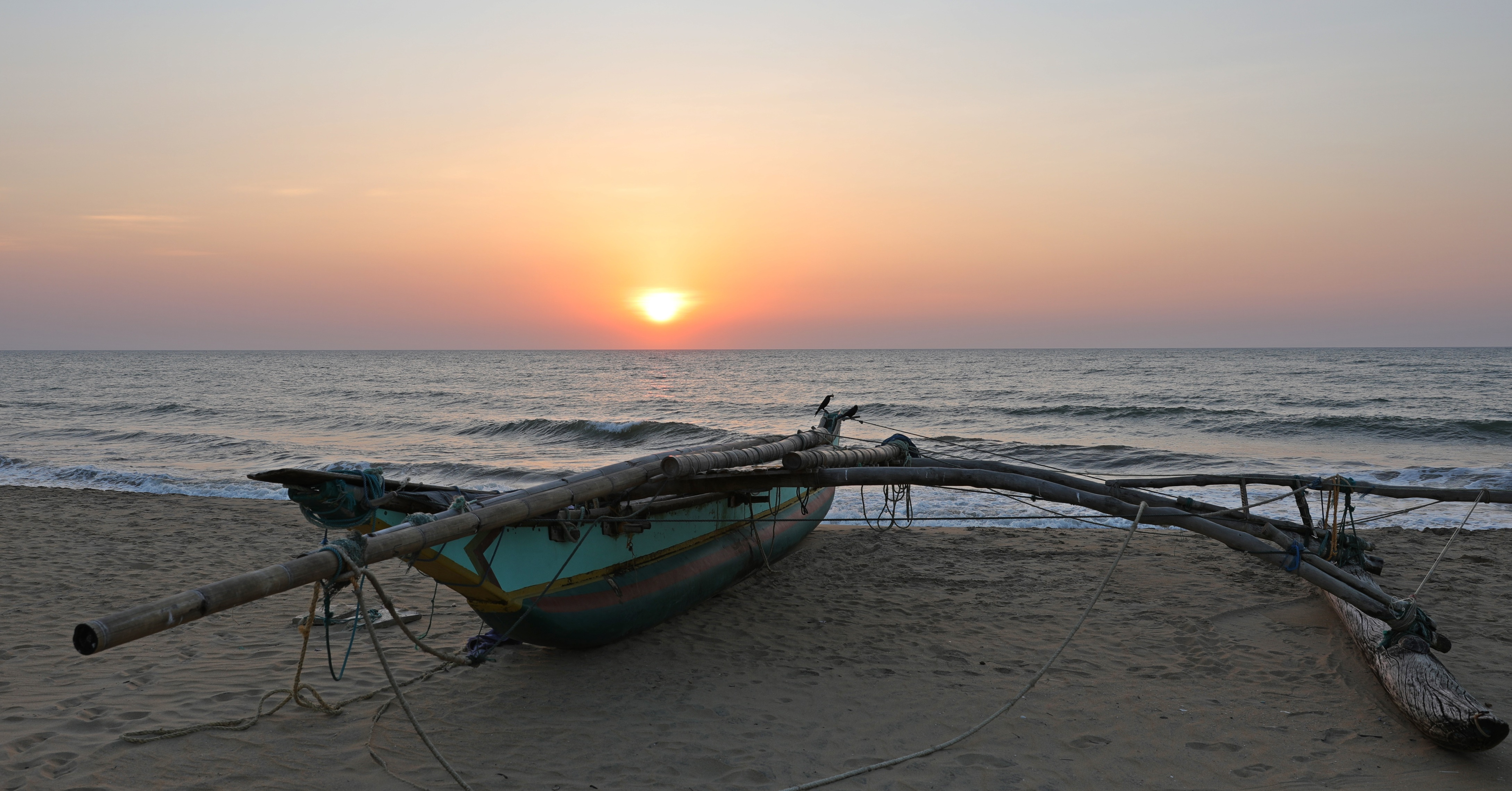 Sunset behind a fishing boat, Negombo Beach