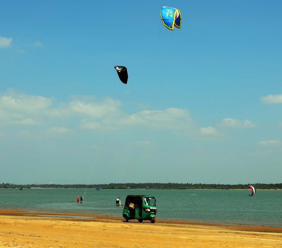Tuk tuk on the beach with Kite surfers, Kalpitiya Lagoon