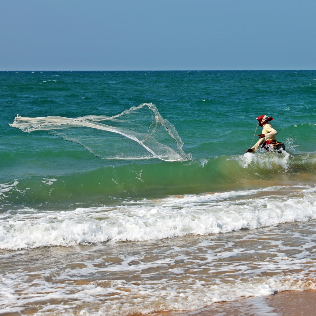 Fisherman casting his net, Kalpitiya