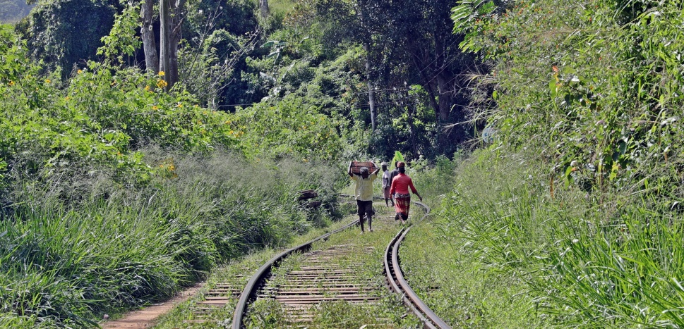 Locals walking on the railroad tracks near Ella