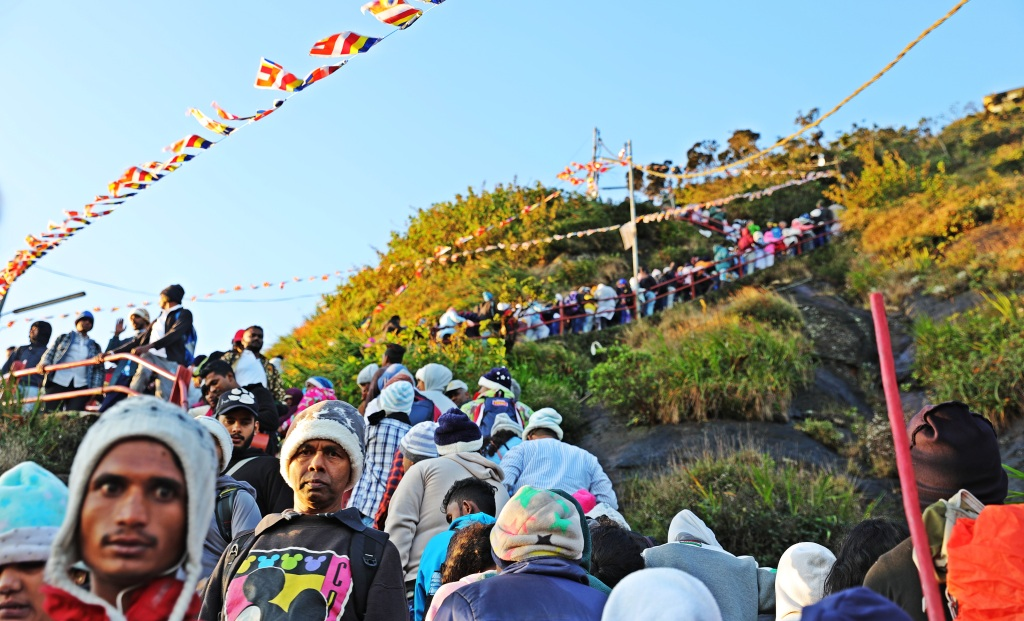 Line of pilgrims going up and coming down Adam's Peak