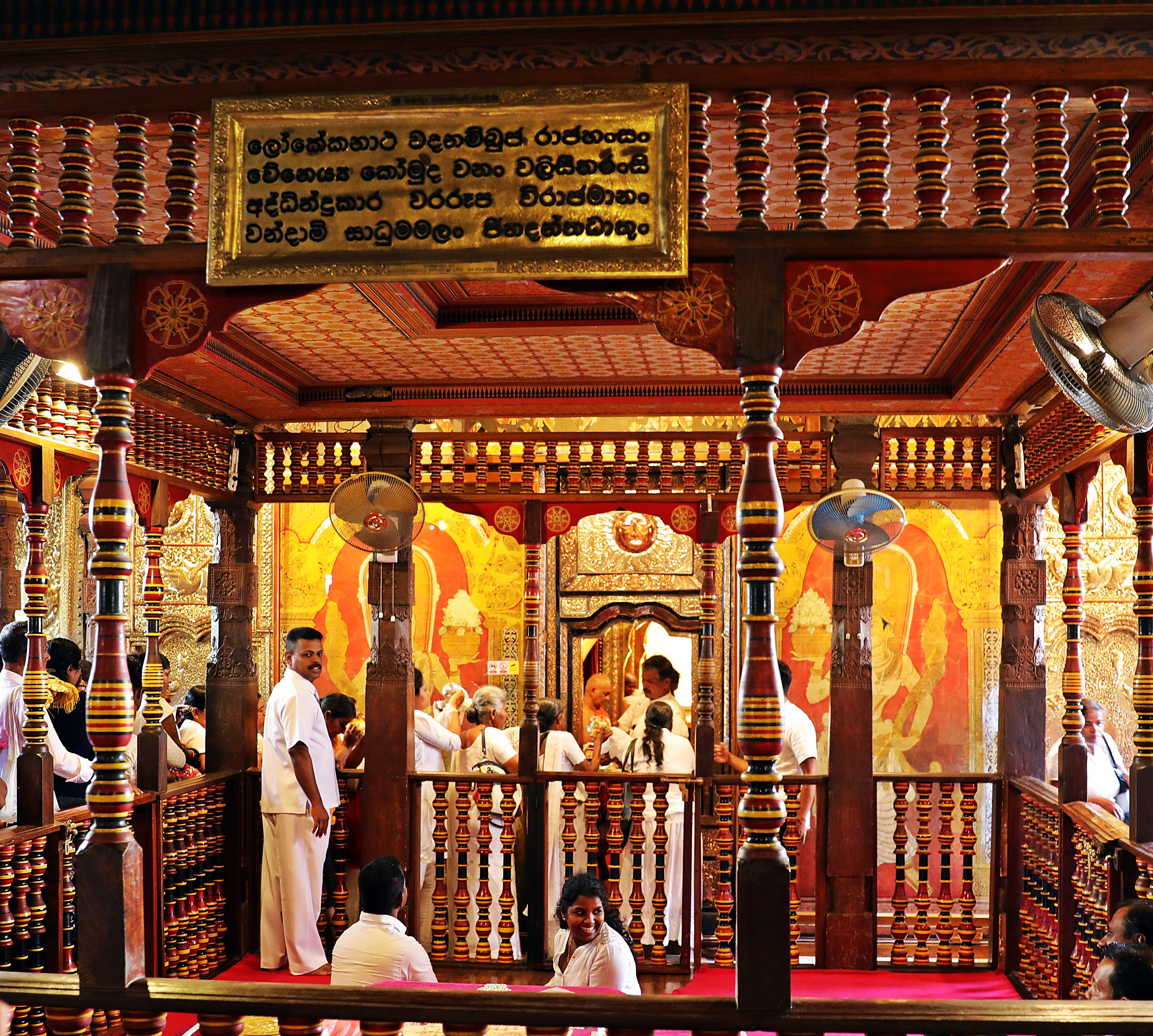 Pilgrims lined up at the golden doors, Temple of the Sacred Tooth Relic