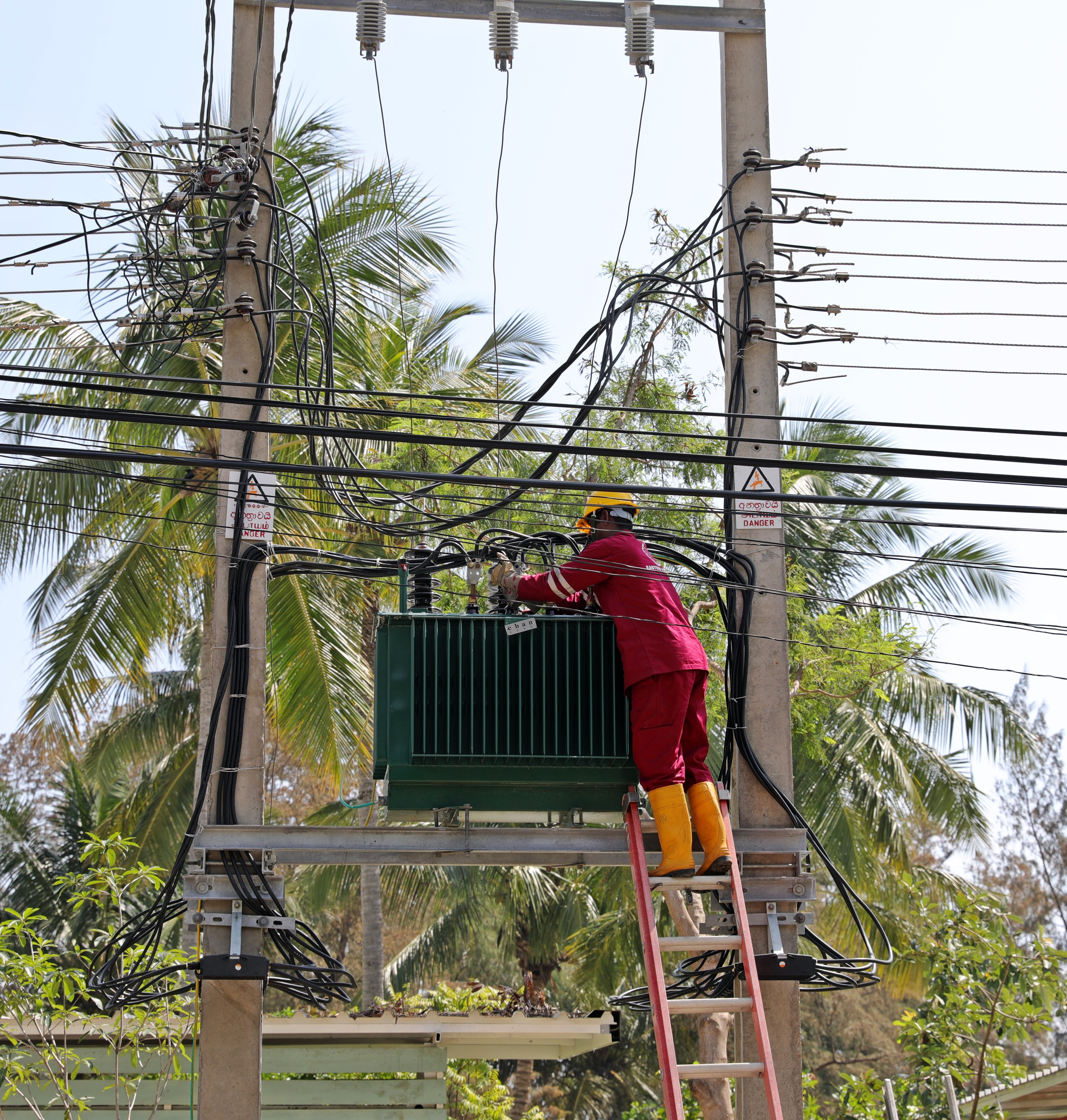 Working on a live power transformer, Arugam Bay