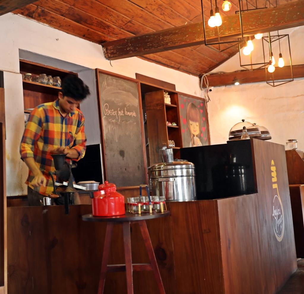 Grinding coffee beans, Kochi