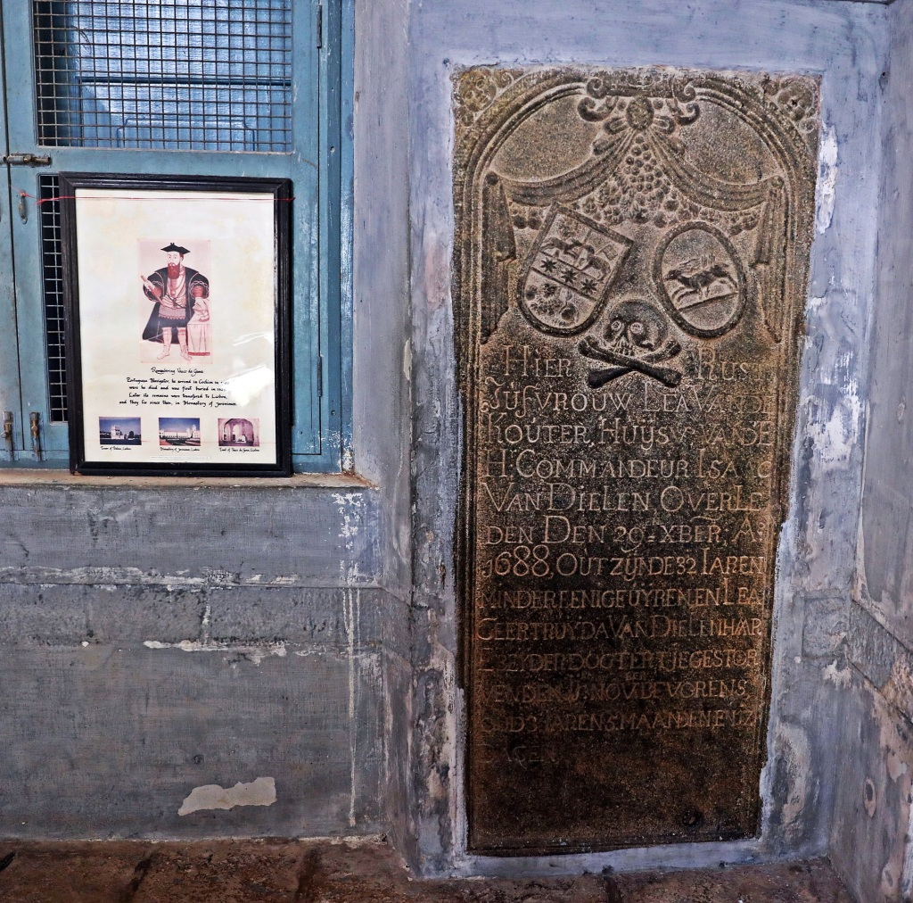 Vasco da Gama's memorial and a burial plaque inside St. Francis Church, Kochi