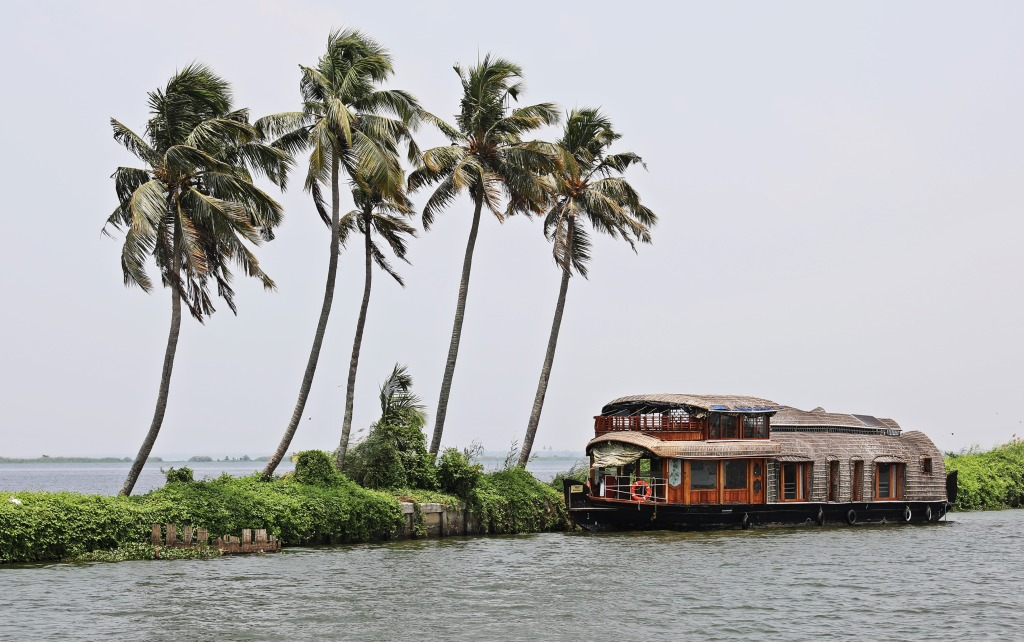 House boat parked on the stone dam, Kerala backwaters