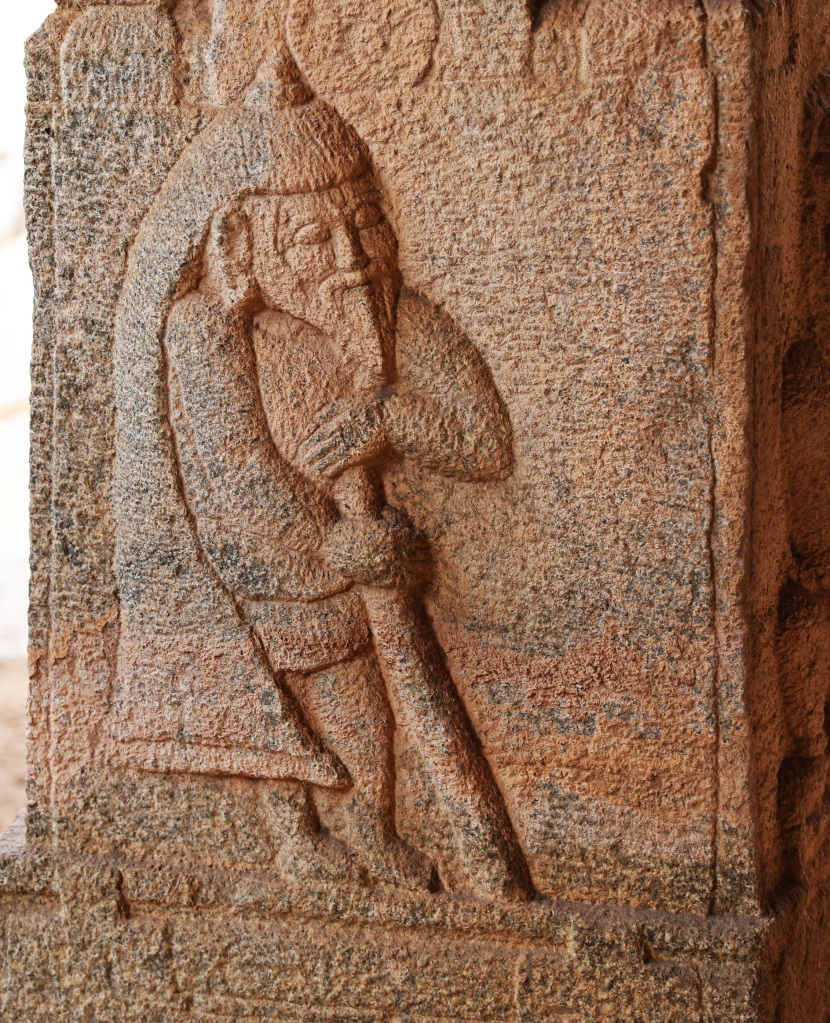Carving of foreign merchant, Hampi