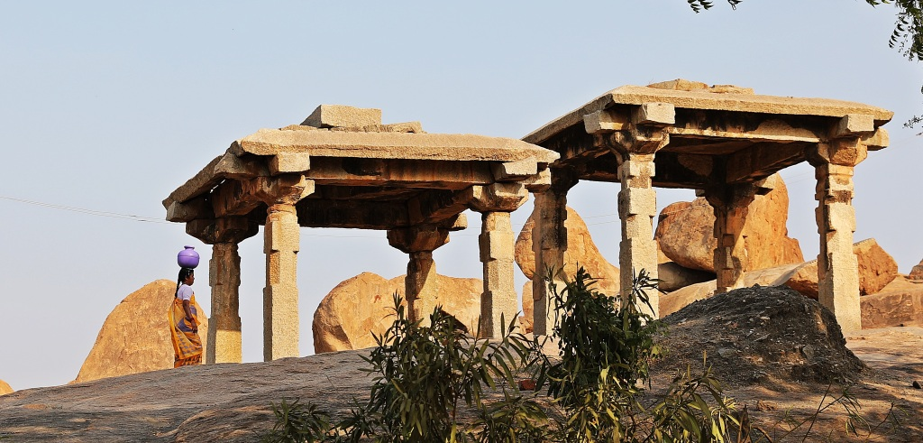 A Hampi women walking through the ruins