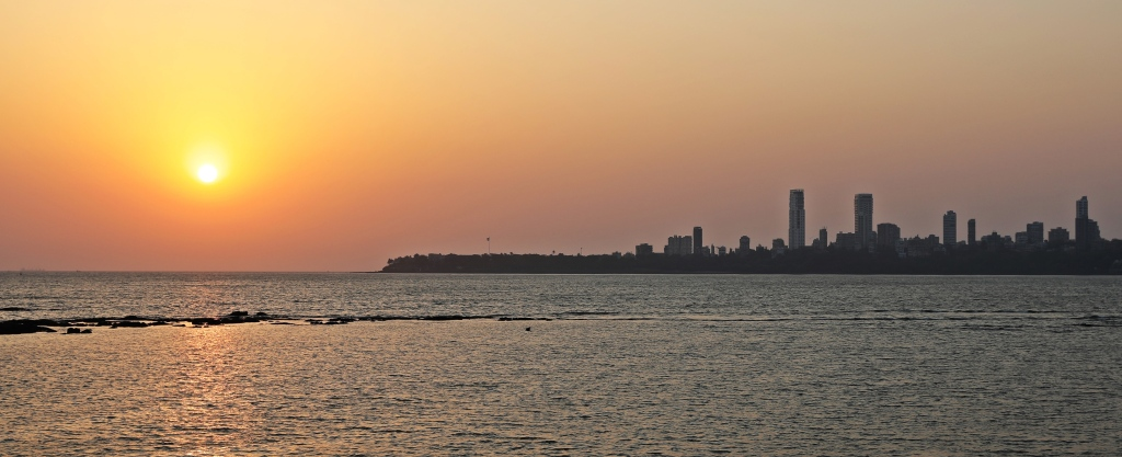 Sunset behind Mumbai skyline from Marine Drive