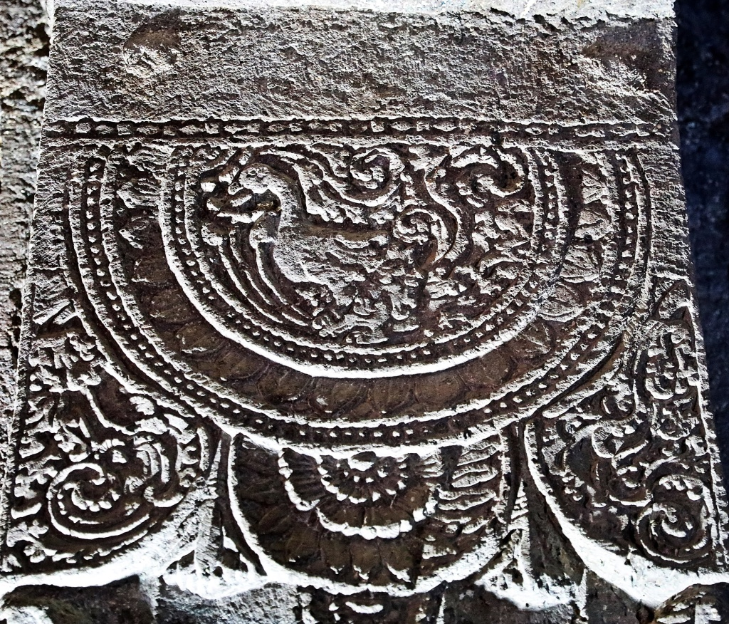 Fine carvings around a duck image, Ajanta