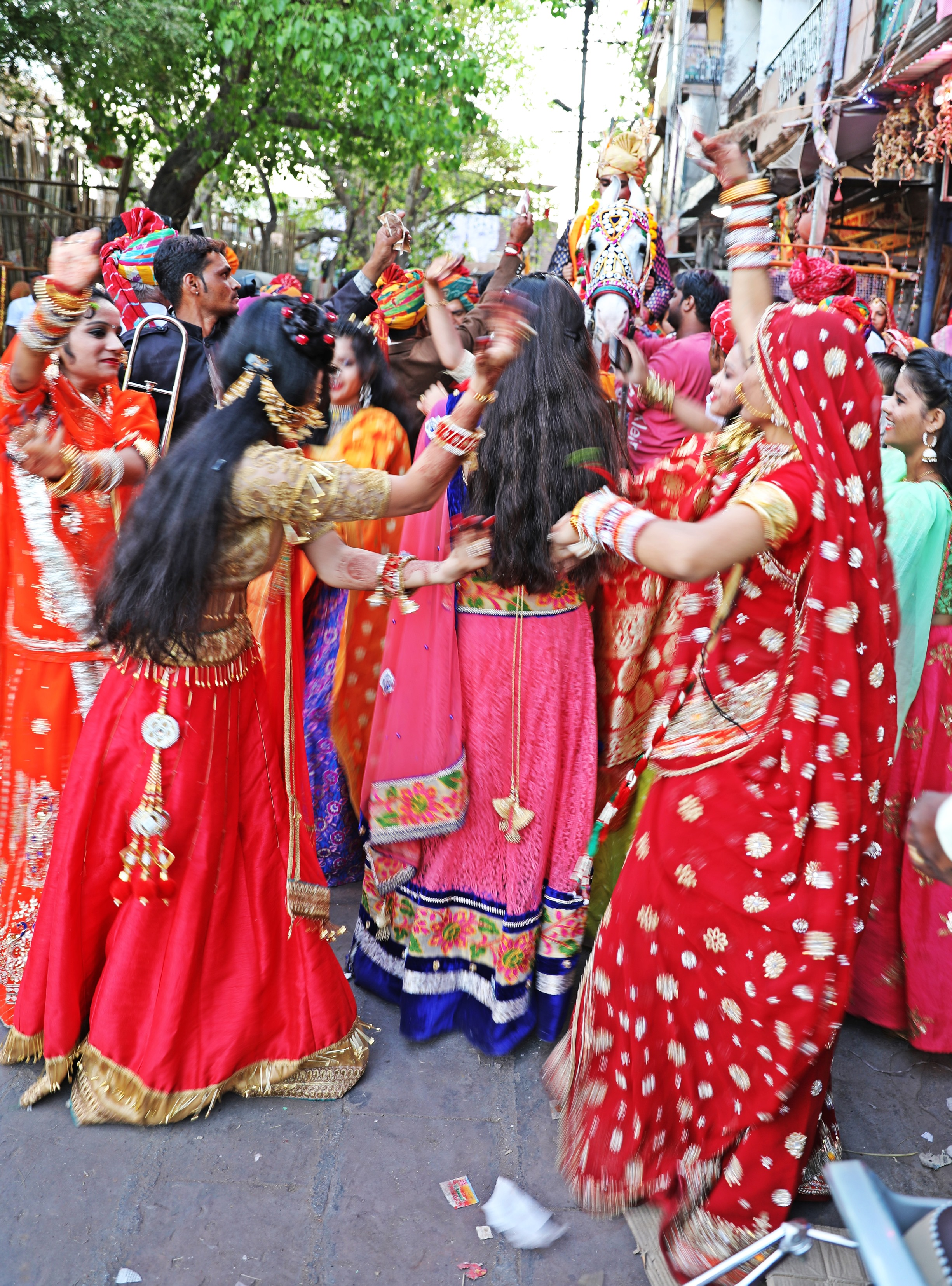 Women dancing in front of the groom on horseback, Jodhpur
