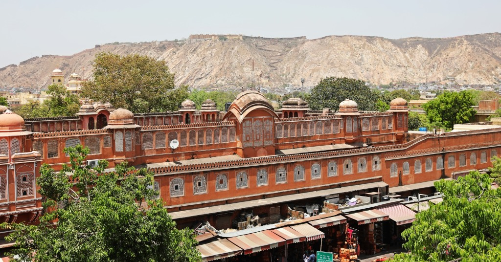 Jaipur market with fort wall behind