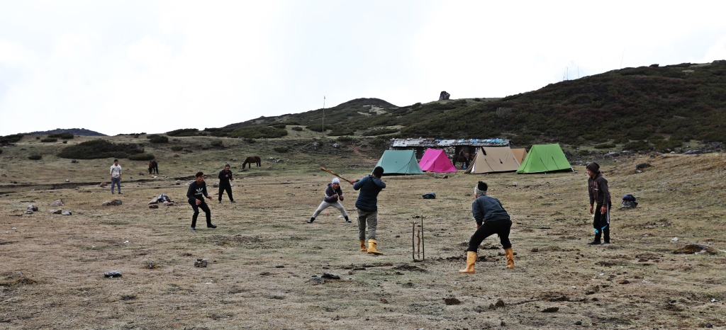 Porters playing cricket, Dorung Camp, Goecha La Trek