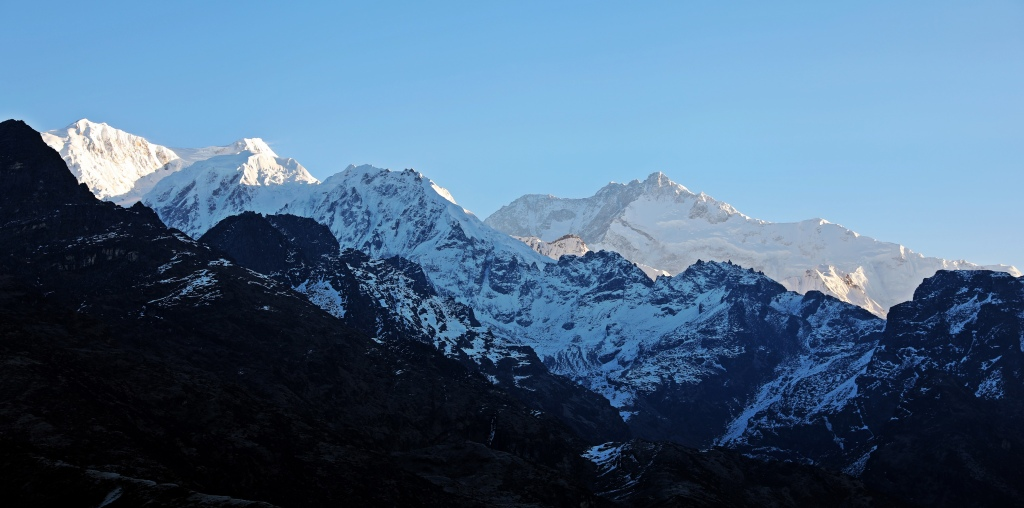 Sunrise reflecting off Kanchenjunga (centre right) from Dzongri Lookout