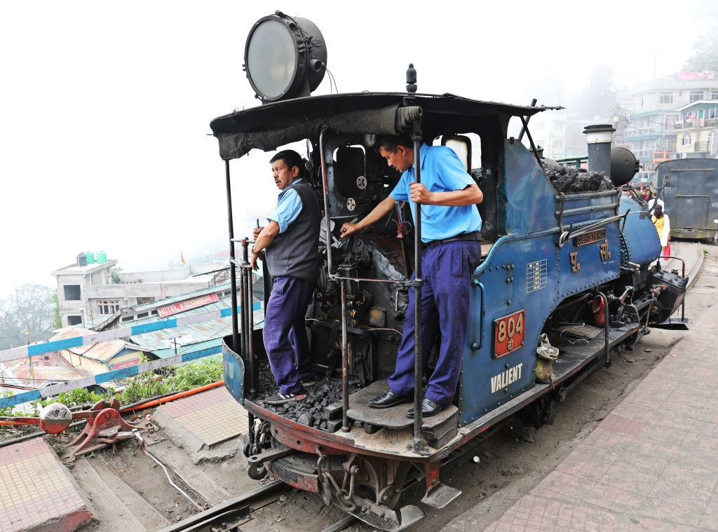 Engineers on Darjeeling's Toy Train locomotive