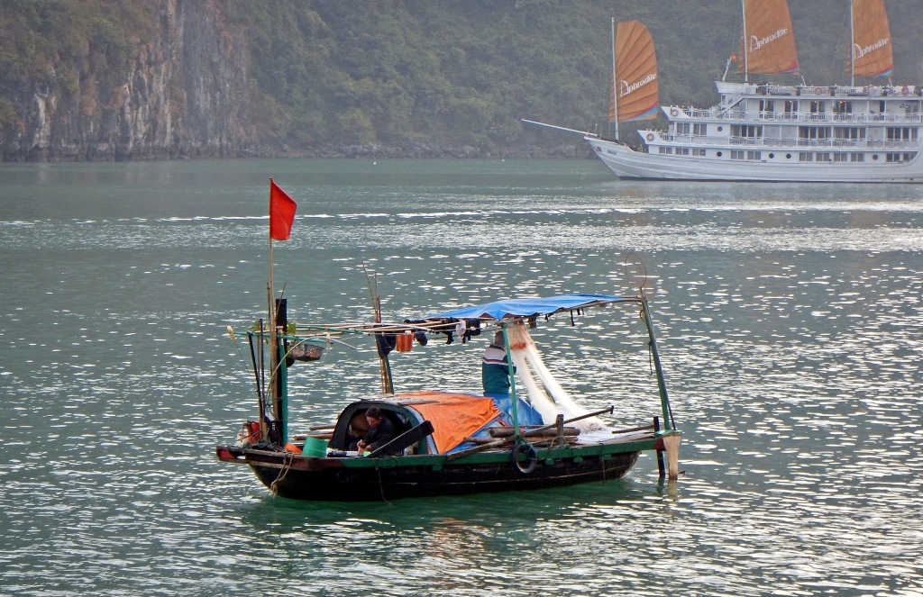 Fishermen on their live-aboard boat, Halong Bay, Vietnam