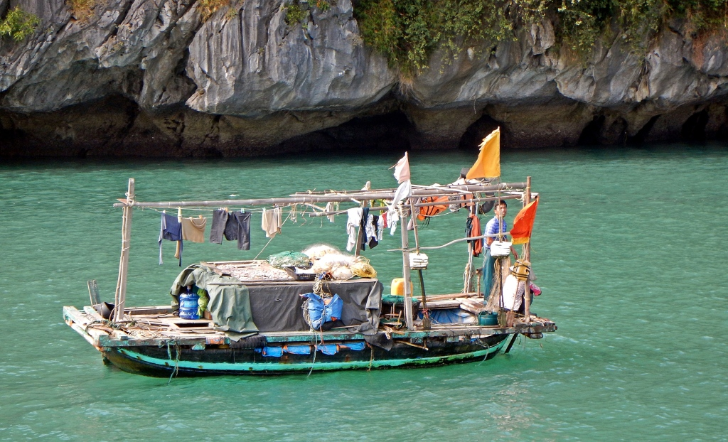 Fishermen on their houseboat, Halong Bay, Vietnam