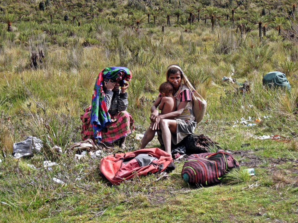 Porters' wives and baby, Carstensz Pyramid Trek
