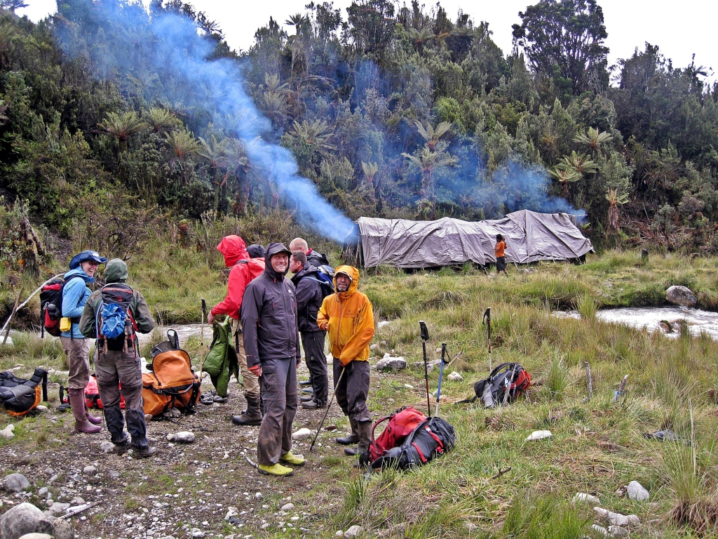 Camp with porters' shelter behind, Carstensz Pyramid Trek