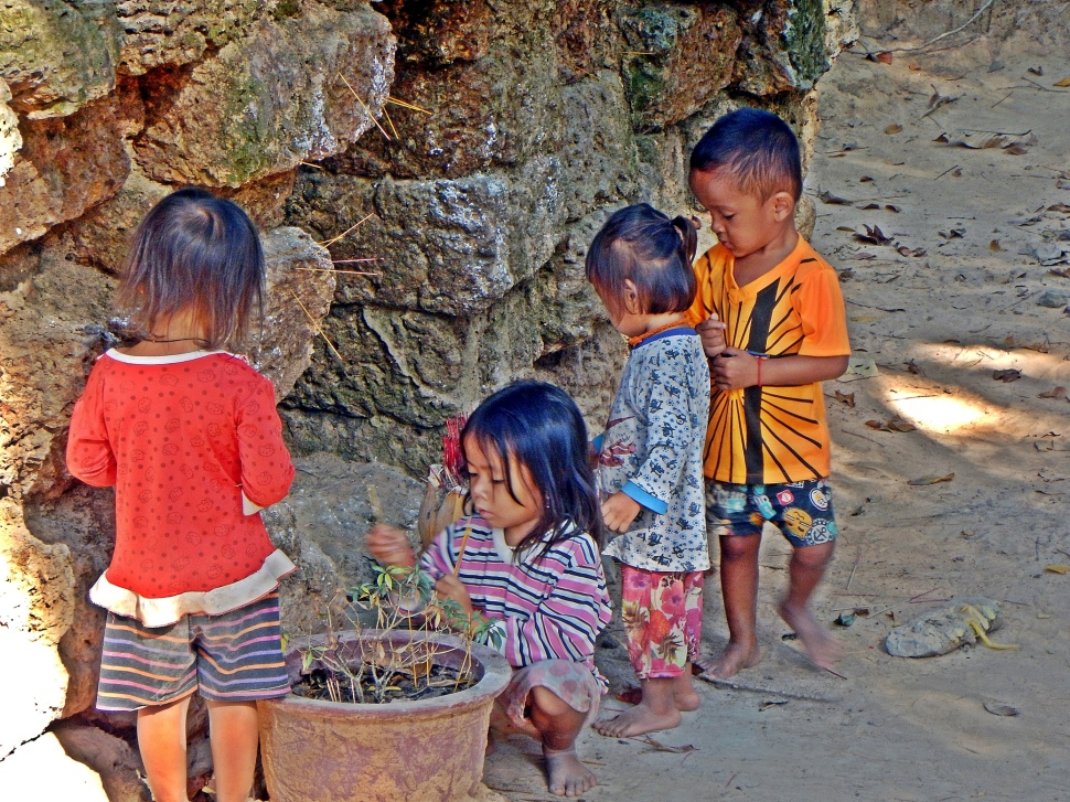 Local kids lighting incense, Angkor