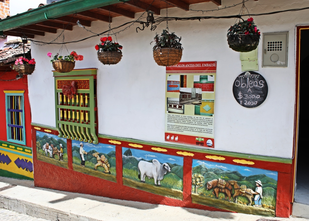 Colourful pastoral scenes on a house, Guatape