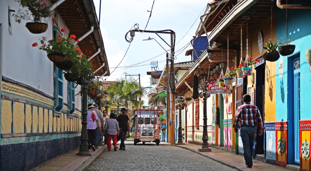 Colourful streets of Guatape, including a colourful tuk-tuk