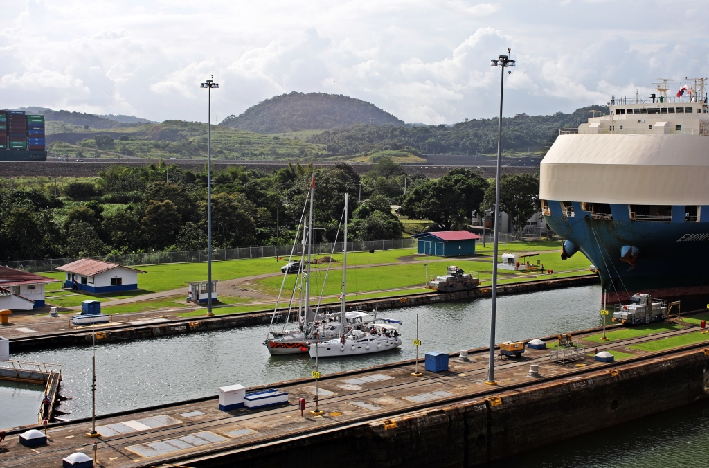 Sailboats and large ship with highest water level, Panama Canal