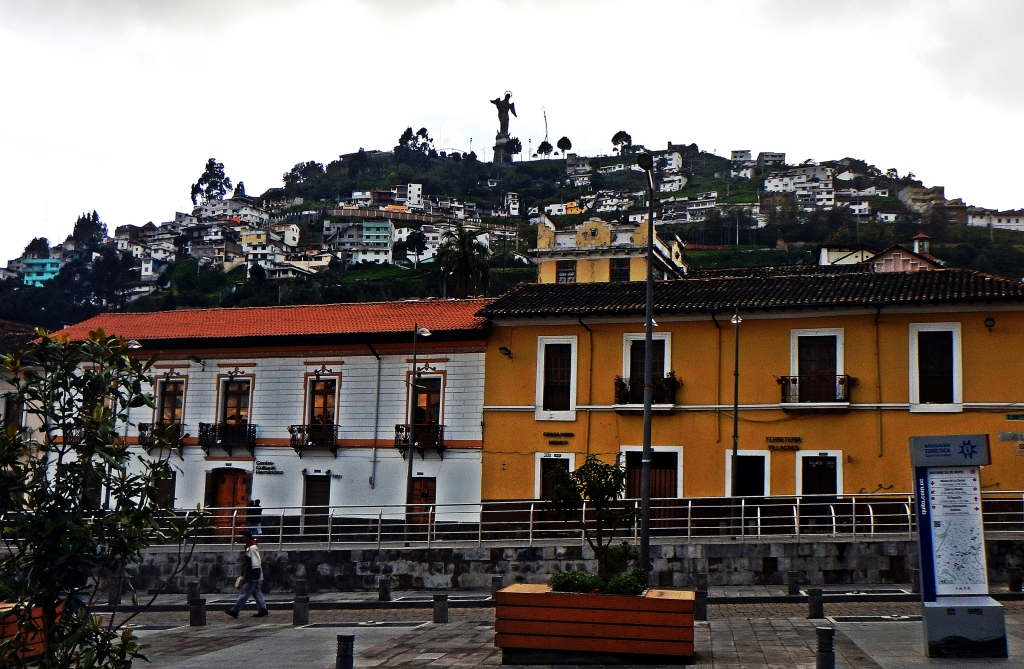 Virgin of Quito statue above colonial buildings