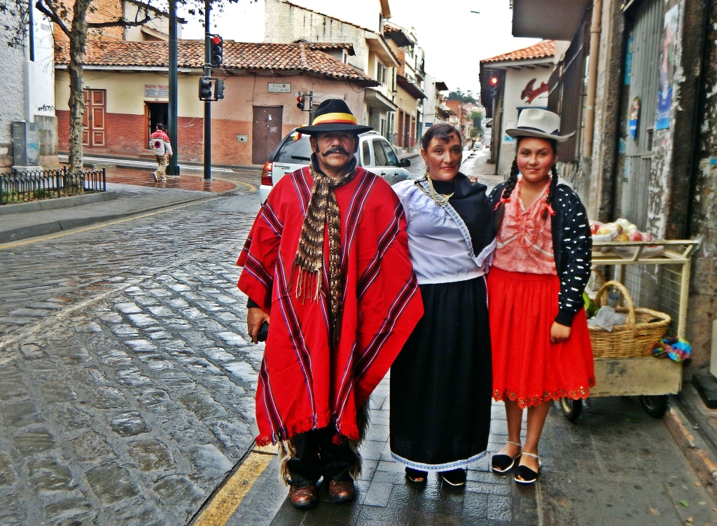 Local family dressed up for the parade, Cuenca