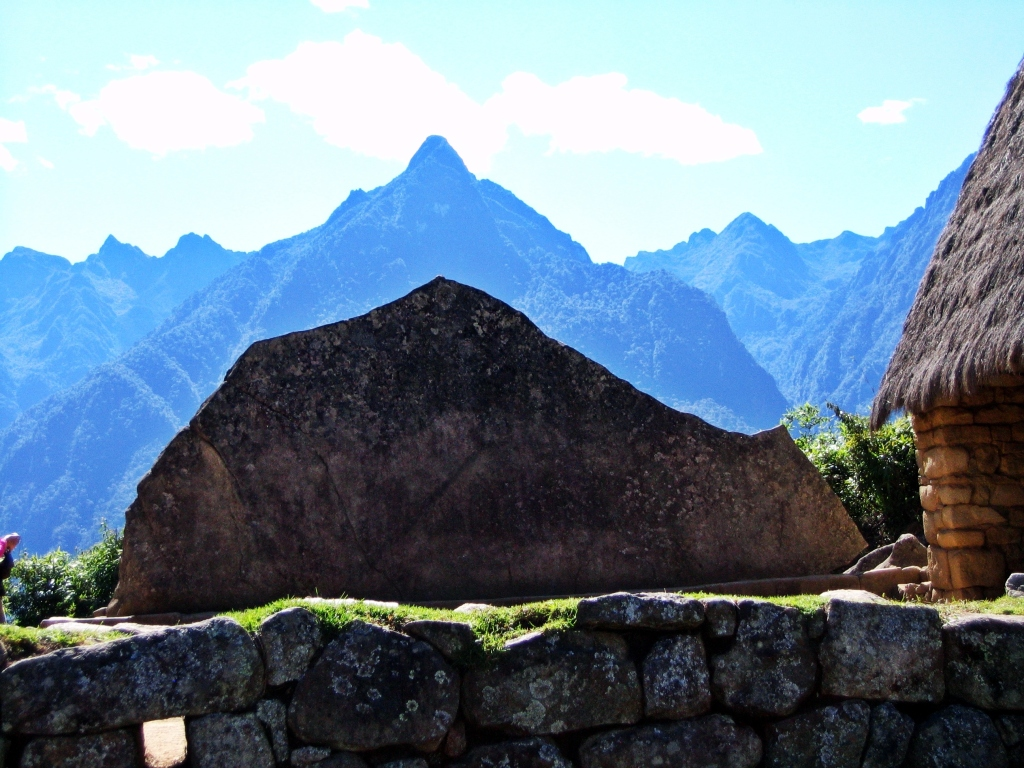 Carved stone to match Yanantin Mountain in the background, Machu Picchu