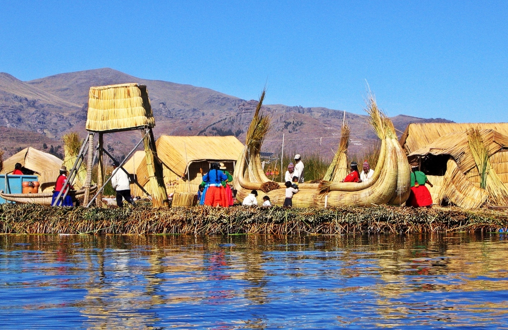 Floating reed village and boats, Lake Titicaca