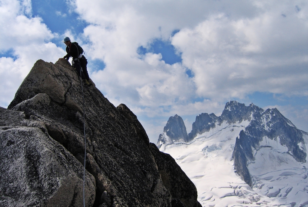 Climbing Bugaboo Spire with Howser Towers in the distance