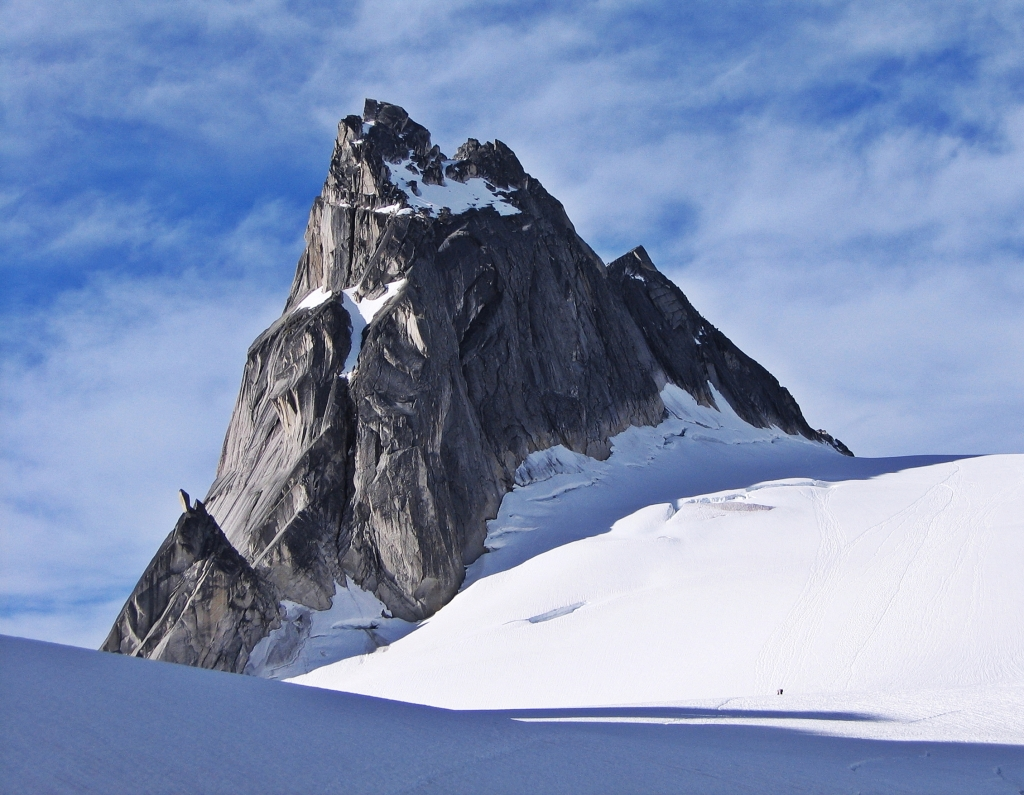 Can you see the climbers on the glacier below Pigeon Spire?