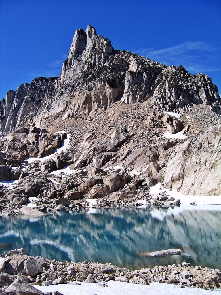Donkey Ears reflecting in a glacier tarn, Bugaboos