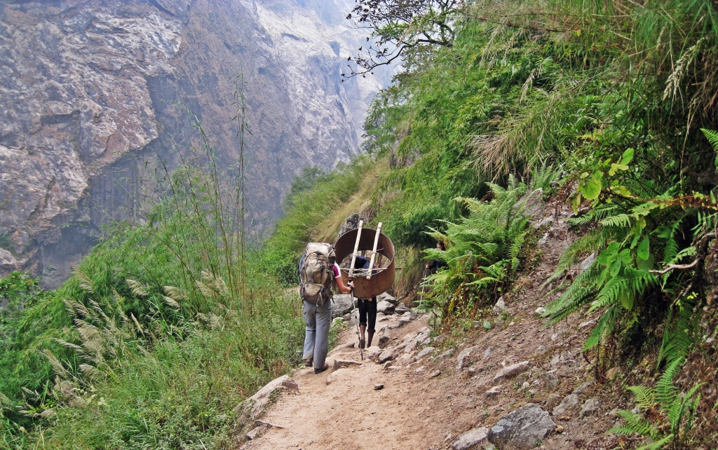 Following a porter, Annapurna Circuit Trek