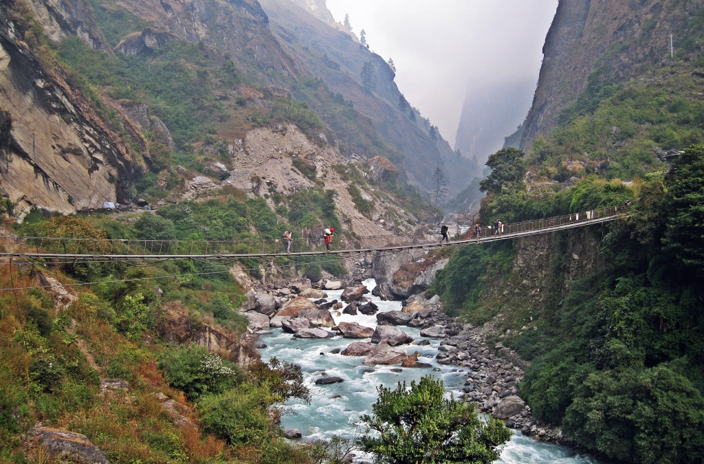Road construction on the left, suspension bridge over the Marsyangdi River, Annapurna Circuit Trek