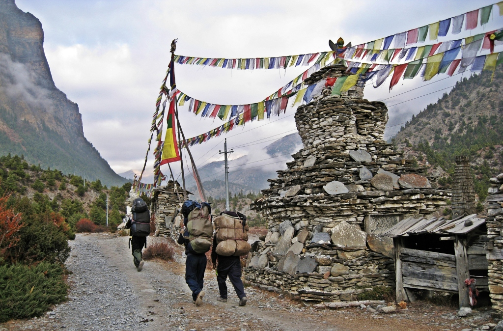 Chortens and porters, Annapurna Circuit Trek