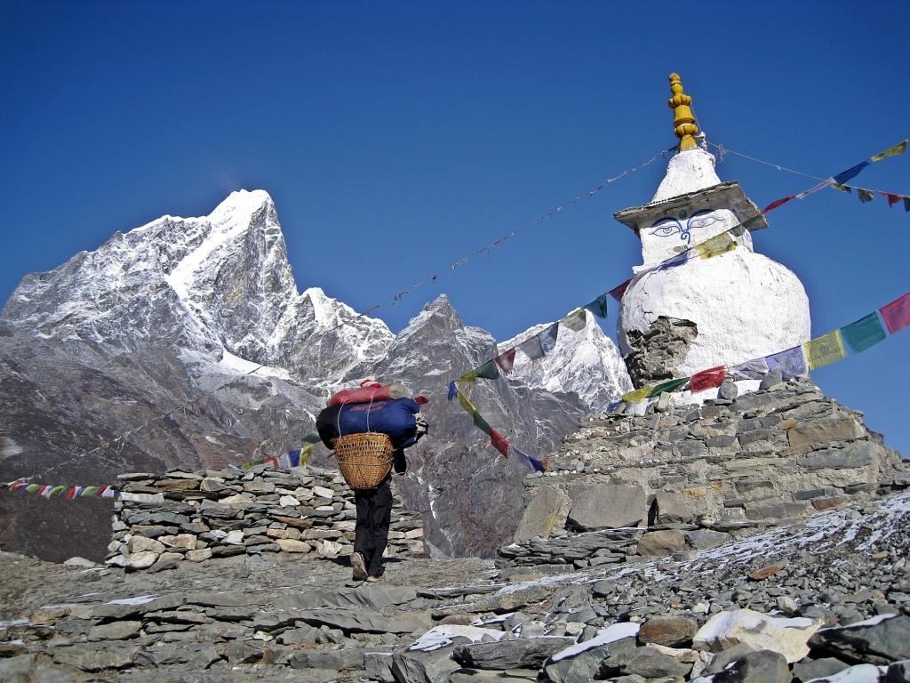 Porter and chorten, above Dingboche, Everest Base Camp Trek