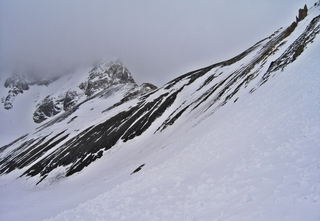 Avalanche debris before a wind-swept Sir Douglas-Robertson Col, French-Robertson Traverse